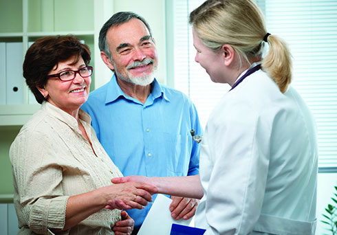A family doctor counseling a senior couple on general health matters